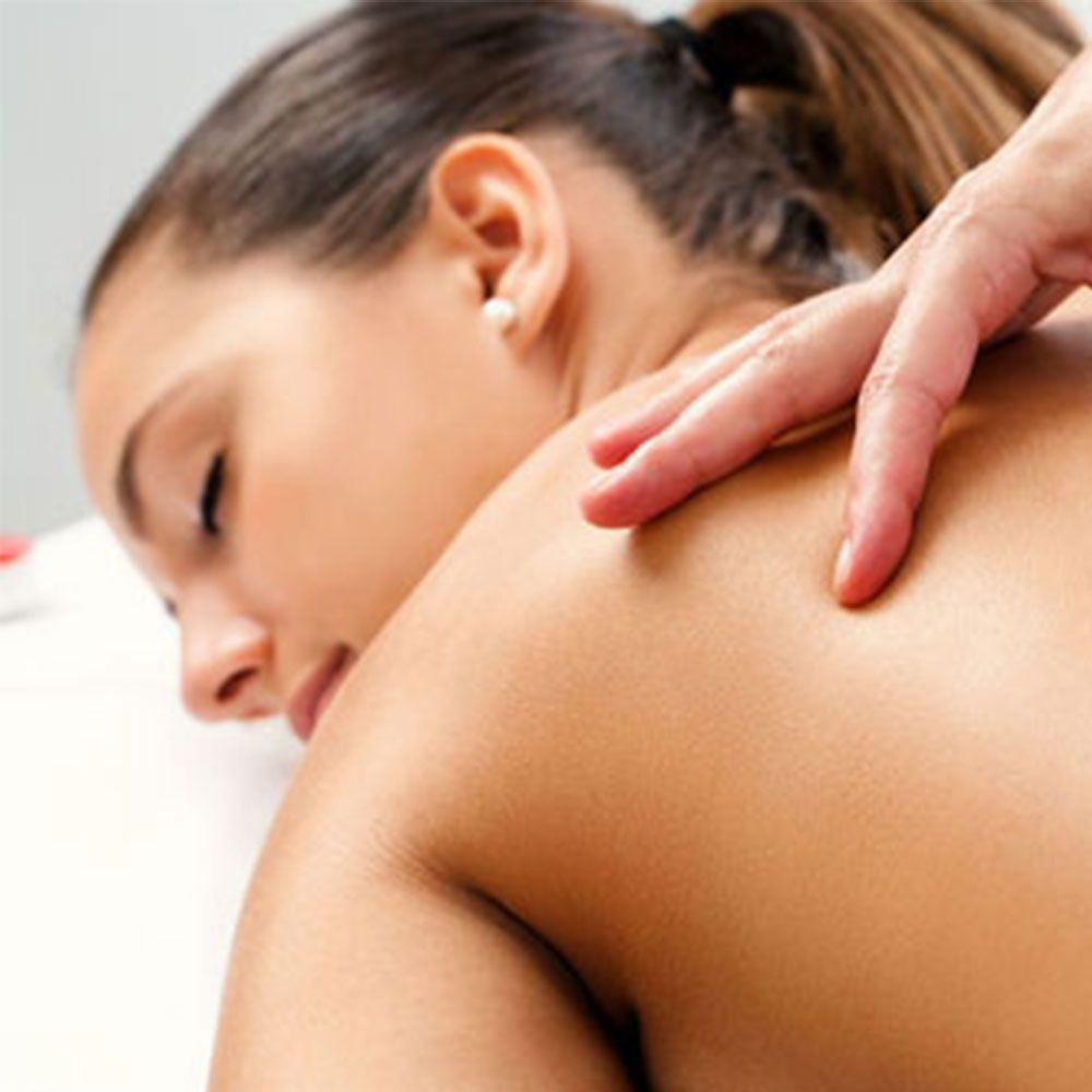 woman releasing tension by massage